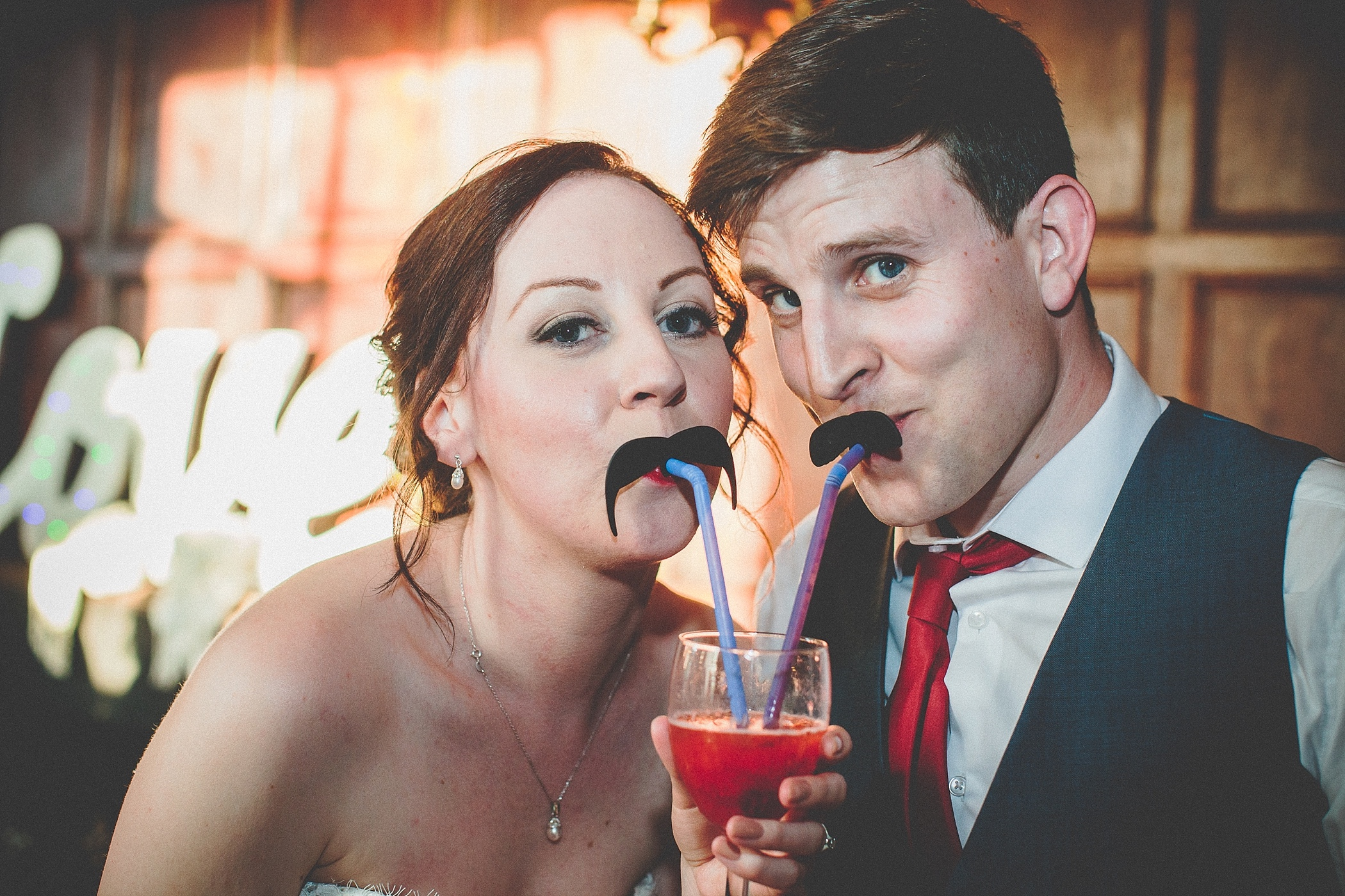 Bride and Groom with moustache straws