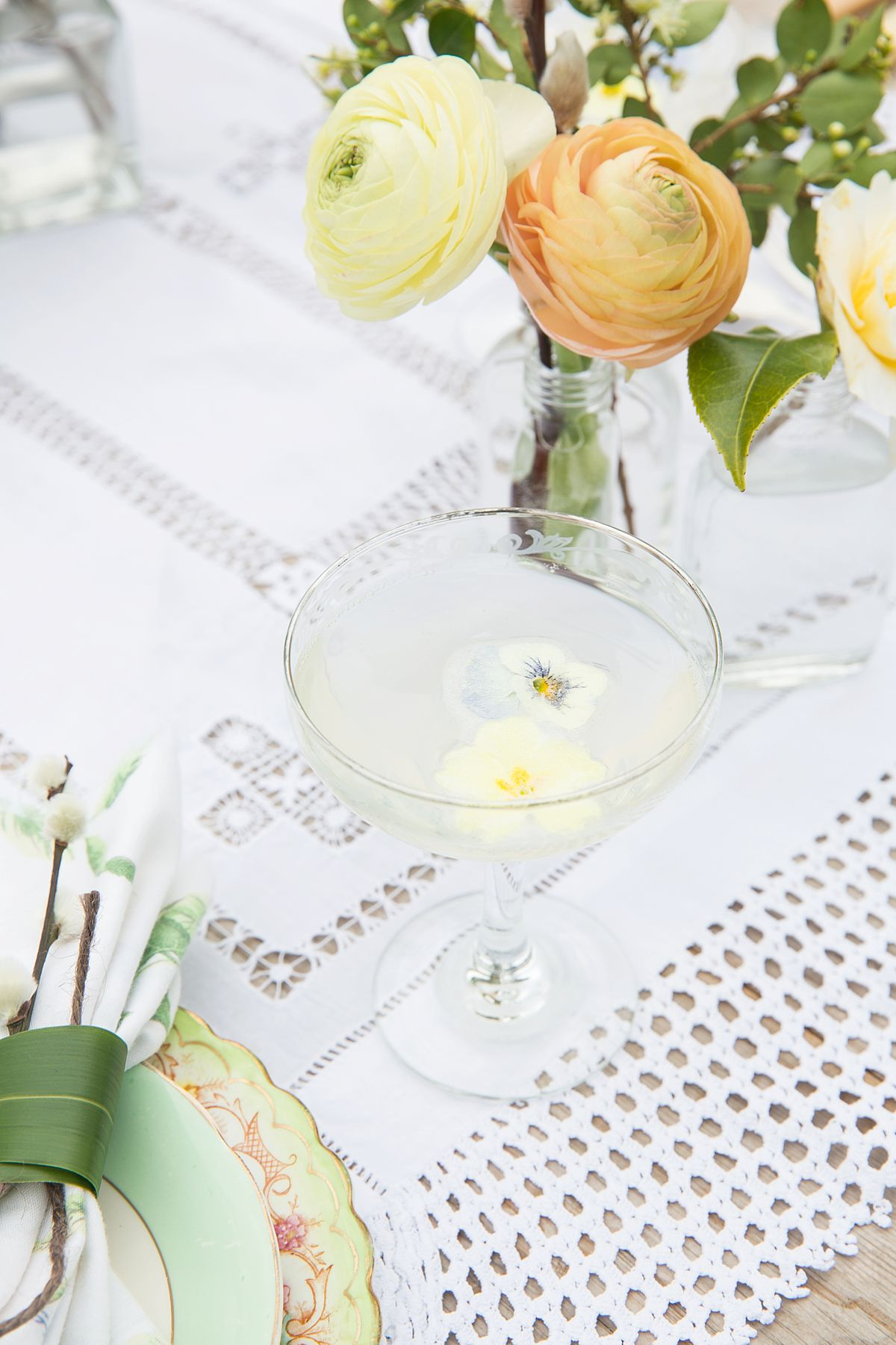 Champagne with floating edible flowers