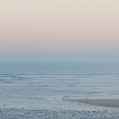 Blue and yellow sunset at Mawgan Porth Beach, Cornwall
