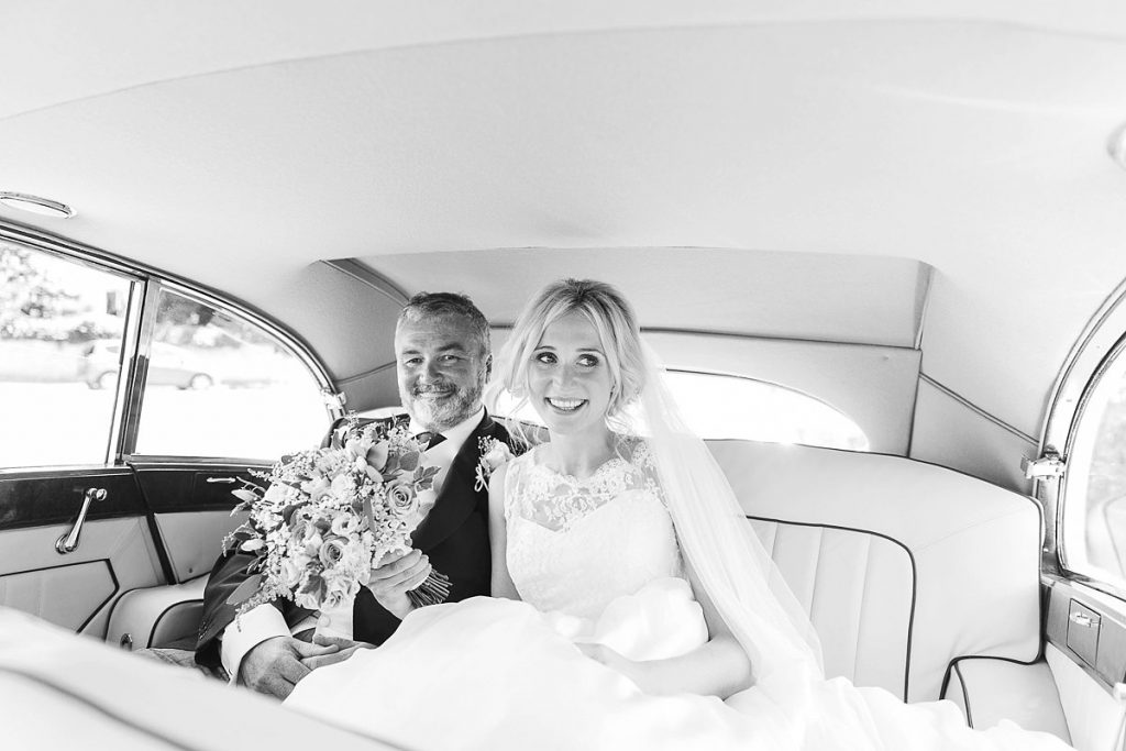 Bride sits in the wedding car with father by Mckenzie brown photography National trust wedding