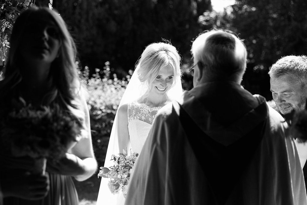 Light hits bride at church wedding by Mckenzie brown photography