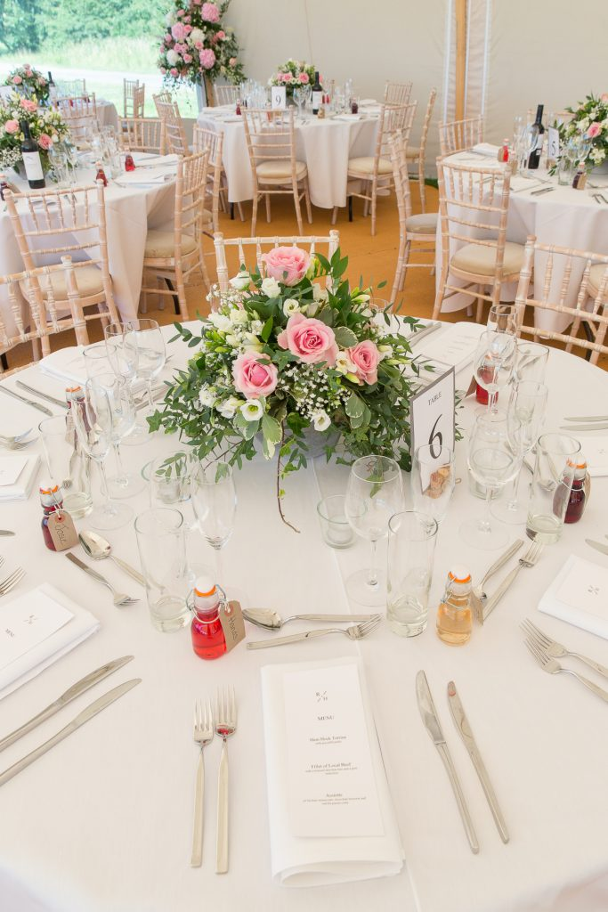 pink wedding flower centrepiece at Lyvededn New Bield wedding by
