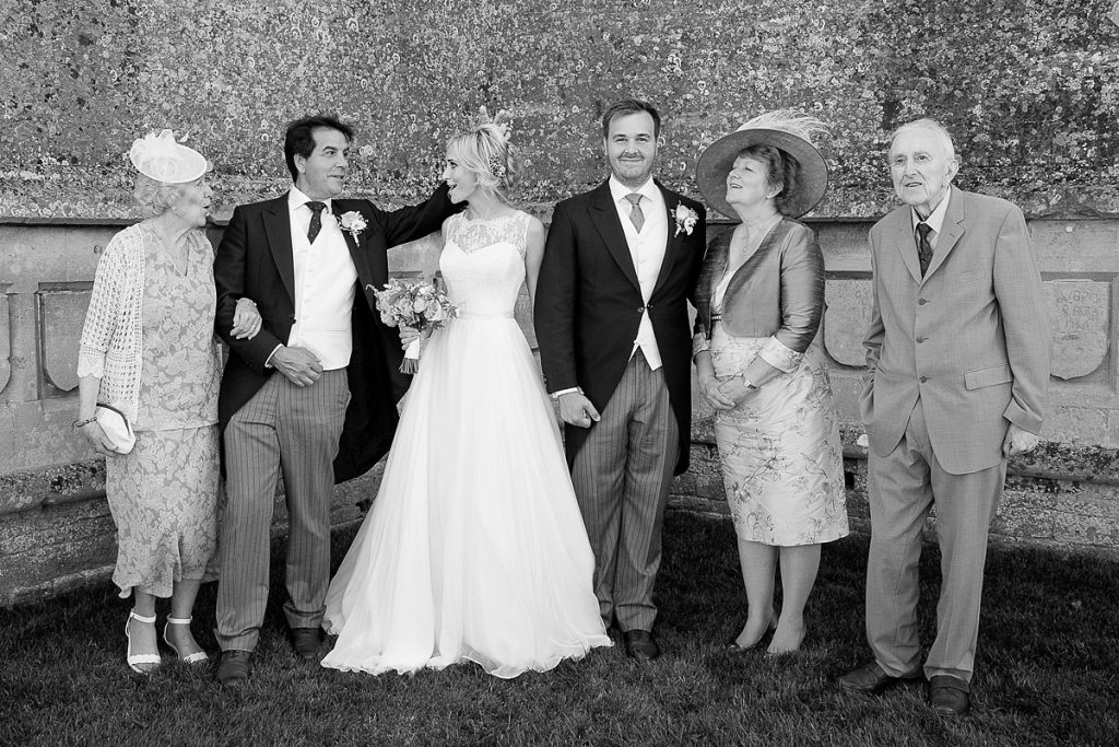 family group shot at wedding in Lyveden New Bield