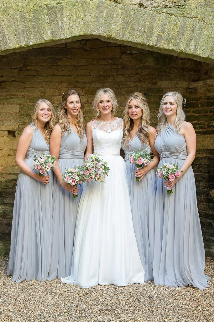 bride and her bridesmaids at Lyveden New Bield National trust by Mckenzie brown photography