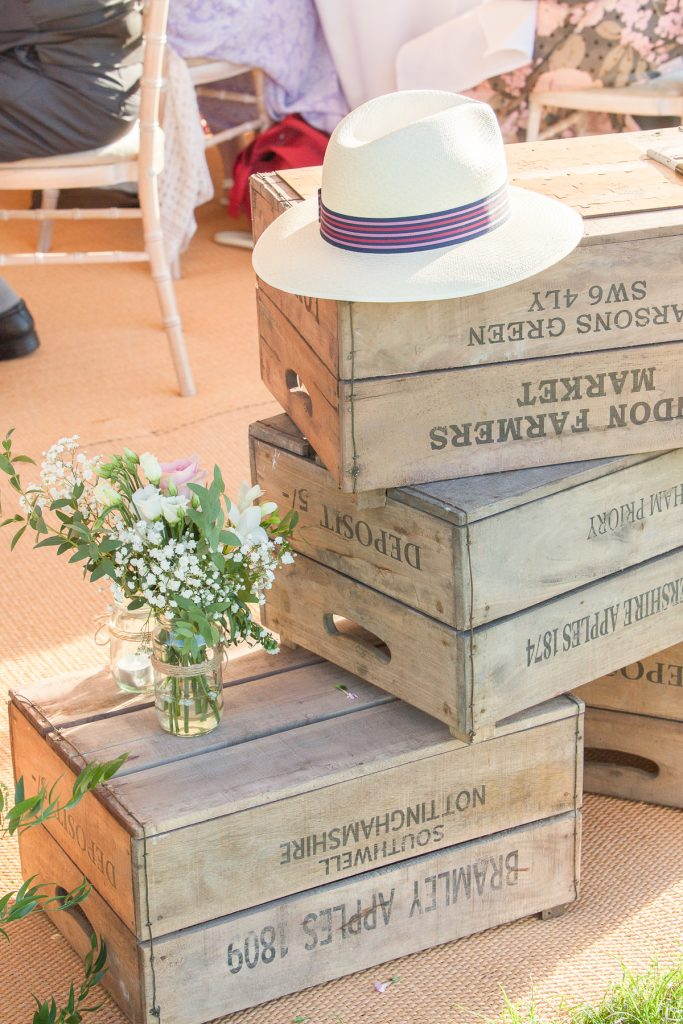 wooden crates at outdoors wedding in Northamptonshire