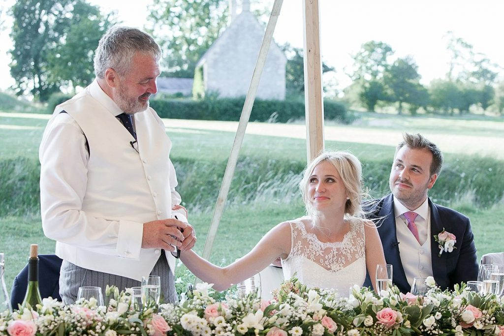 bride reaches out to father during his speech at Lyveden New Bield