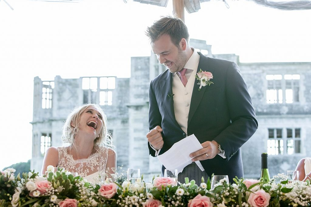 Groom laughs at wedding during speeches at Lyveden new bield