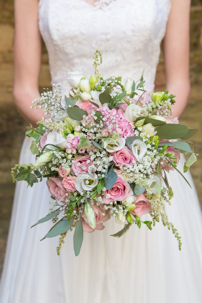 pink and white flower bouquet at summer wedding