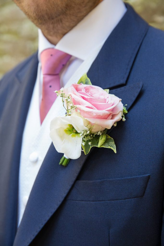 Groom with pink and white buttonhole