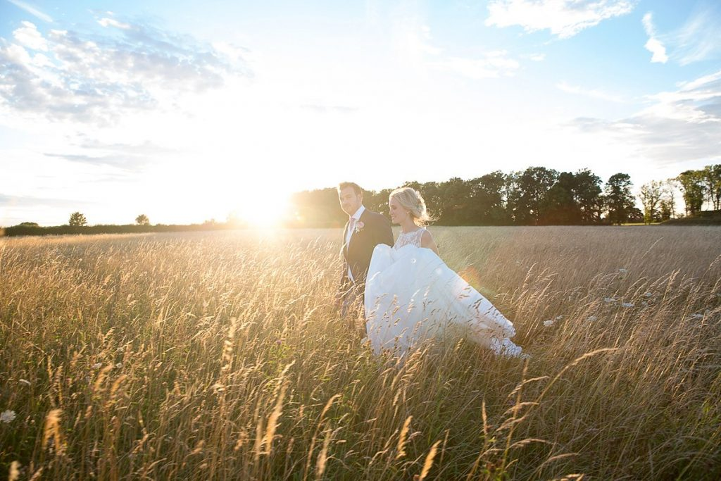 Bride and groom at sunset at Lyveden New Bield National Trust wedding by Mckenzie brown photography