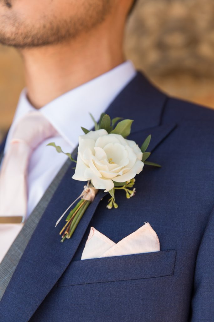 white buttonhole for groom at Pynes House wedding Mckenzie brown Photography