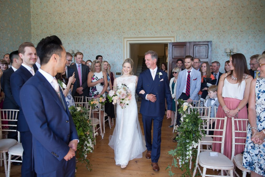 Dad walks bride at wedding at Pynes House