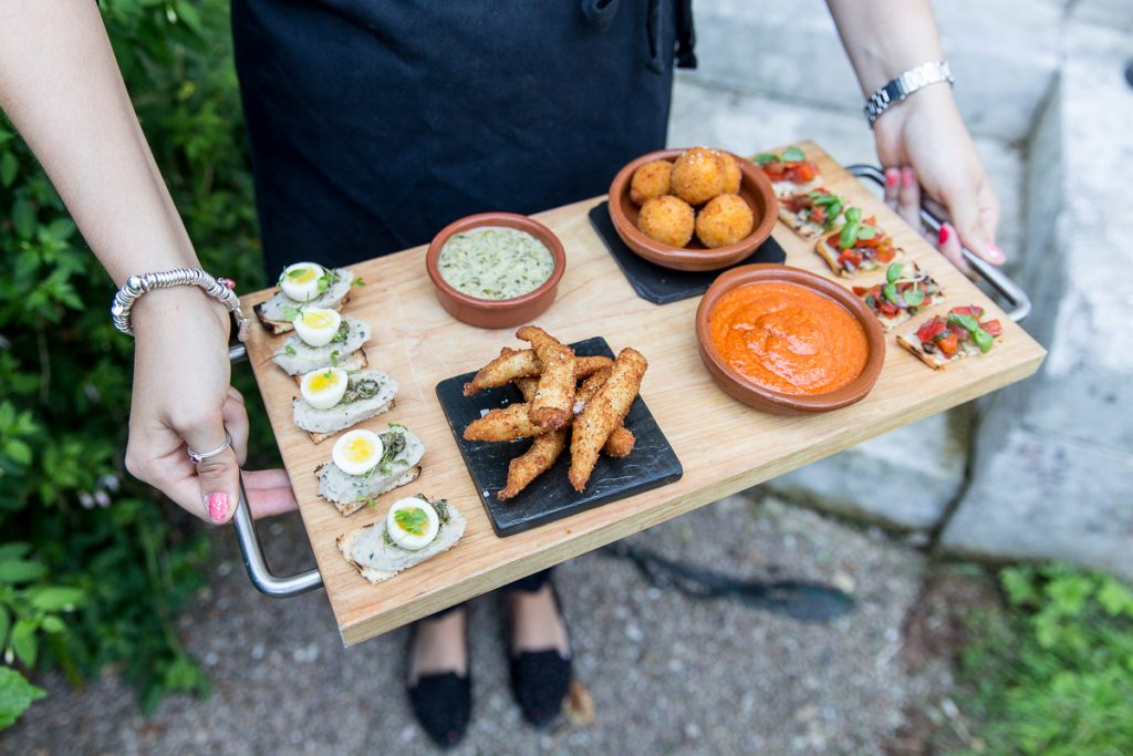 wedding canapes on a wooden tray