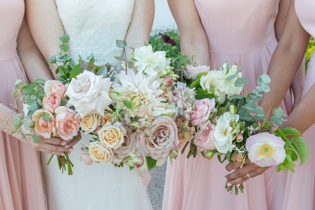 bride and bridesmaid wedding bouquet of white and pink flowers