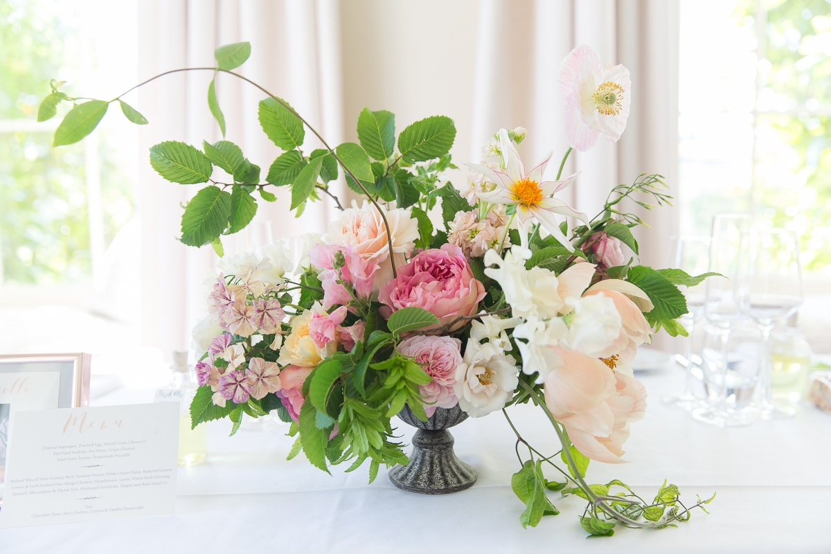 Flowers for the wedding tables by Laura Hingston