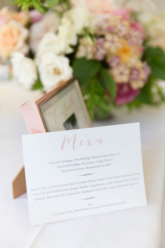 table plan in a wooden frame at pynes house wedding reception