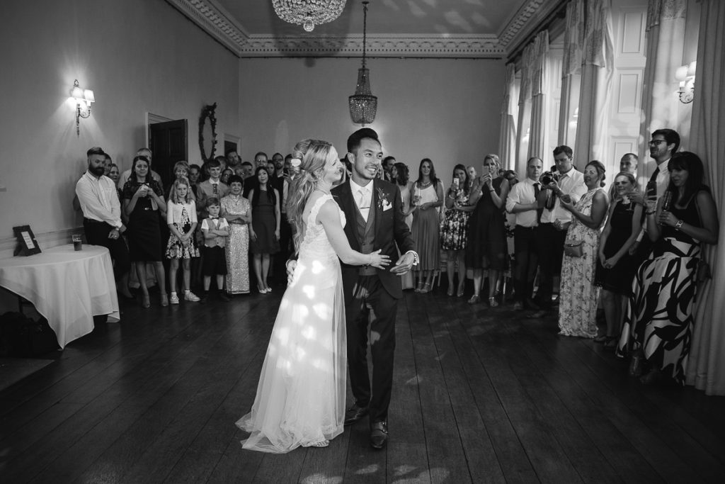 bride and groom finish the first dance at their wedding