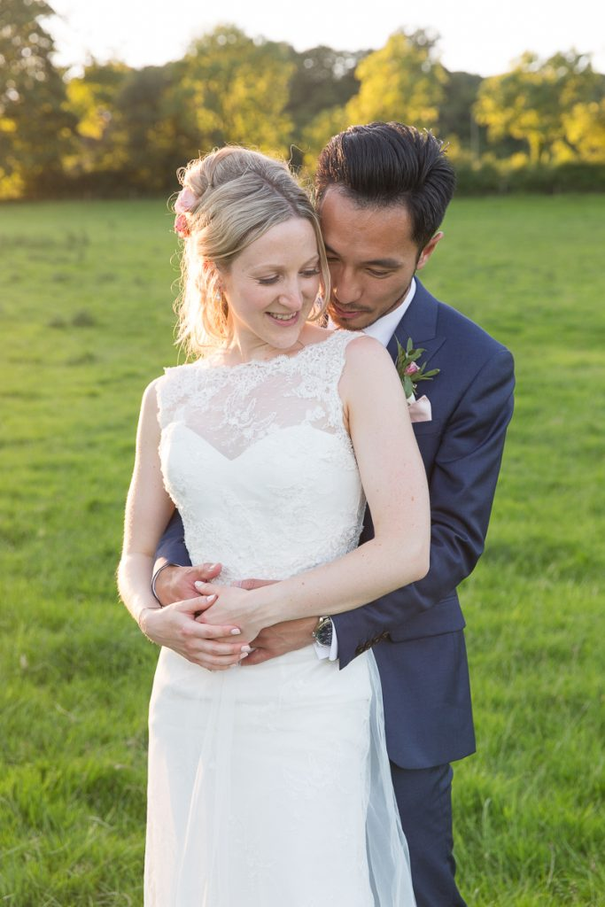 wedding couple embrace in the gardens of pynes house