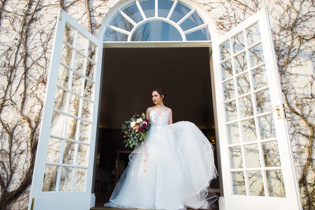 Hayley Paige wedding dress in entrance of orangery at Bridwell