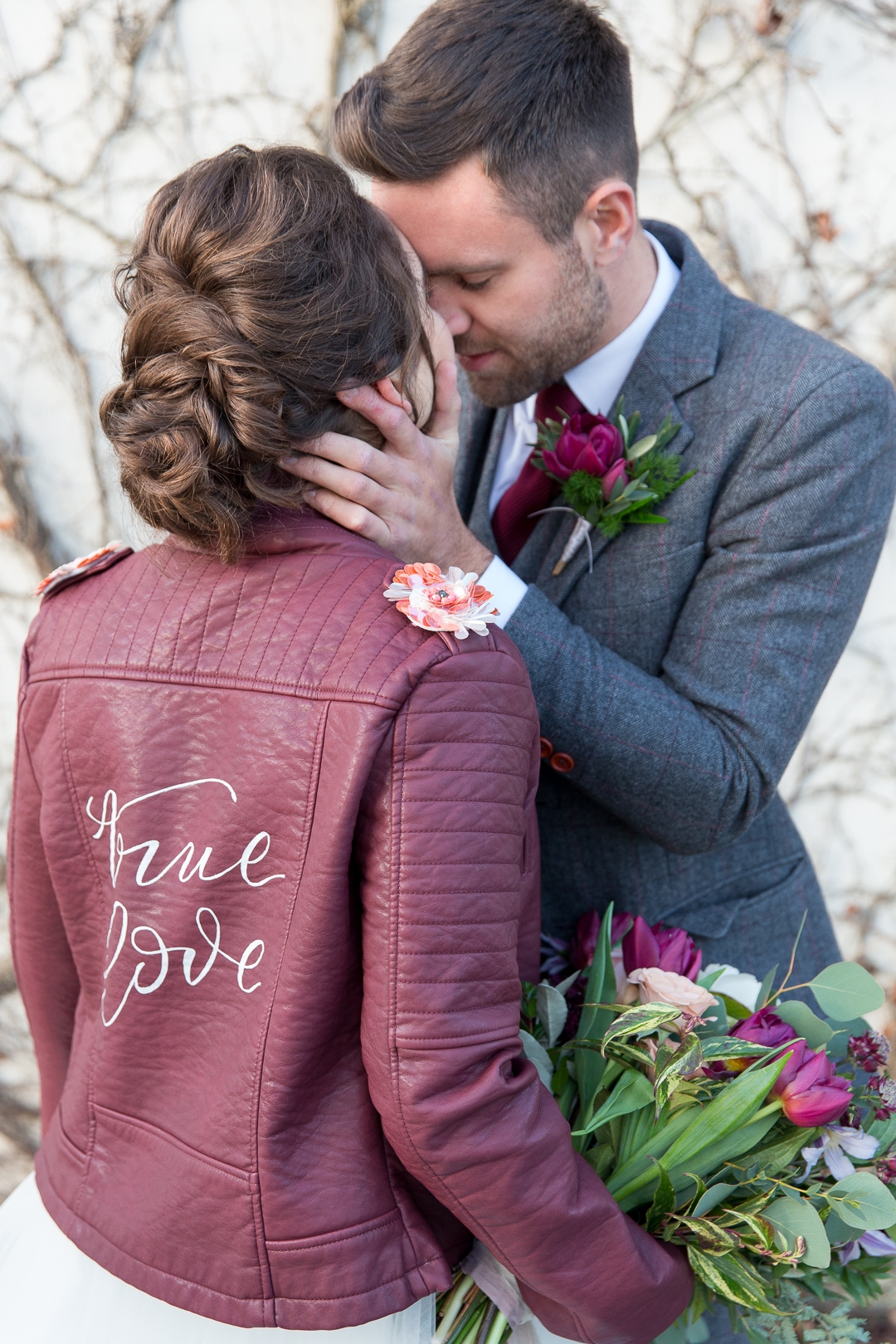 Burgundy leather jacket with True love calligraphy