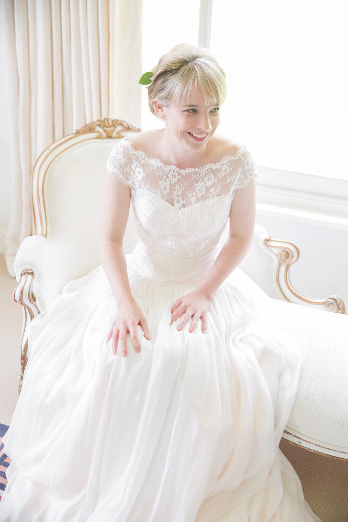 bride sat in window in Naomi Neoh wedding dress