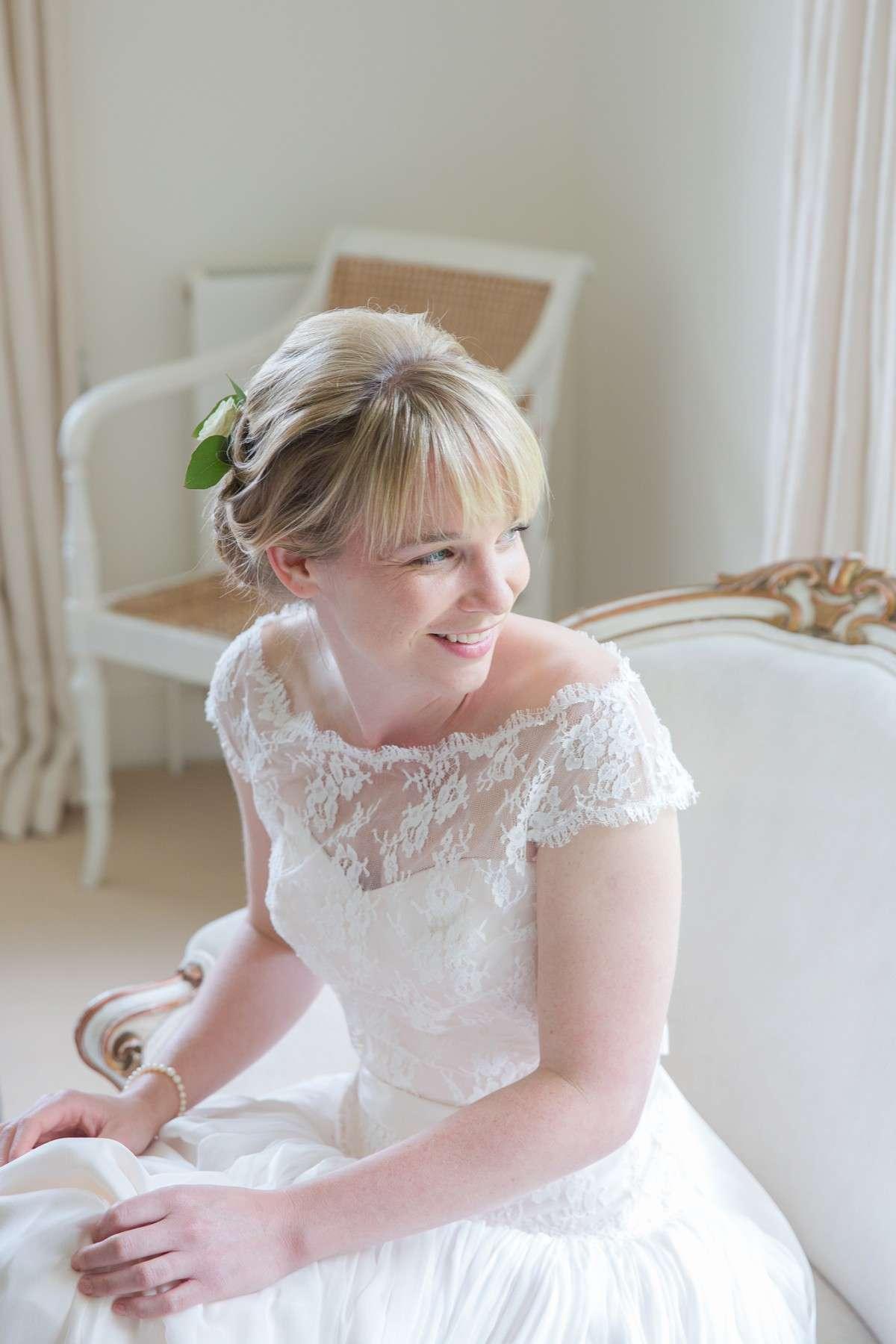 close up of bride wearing Naomi Neoh wedding dress