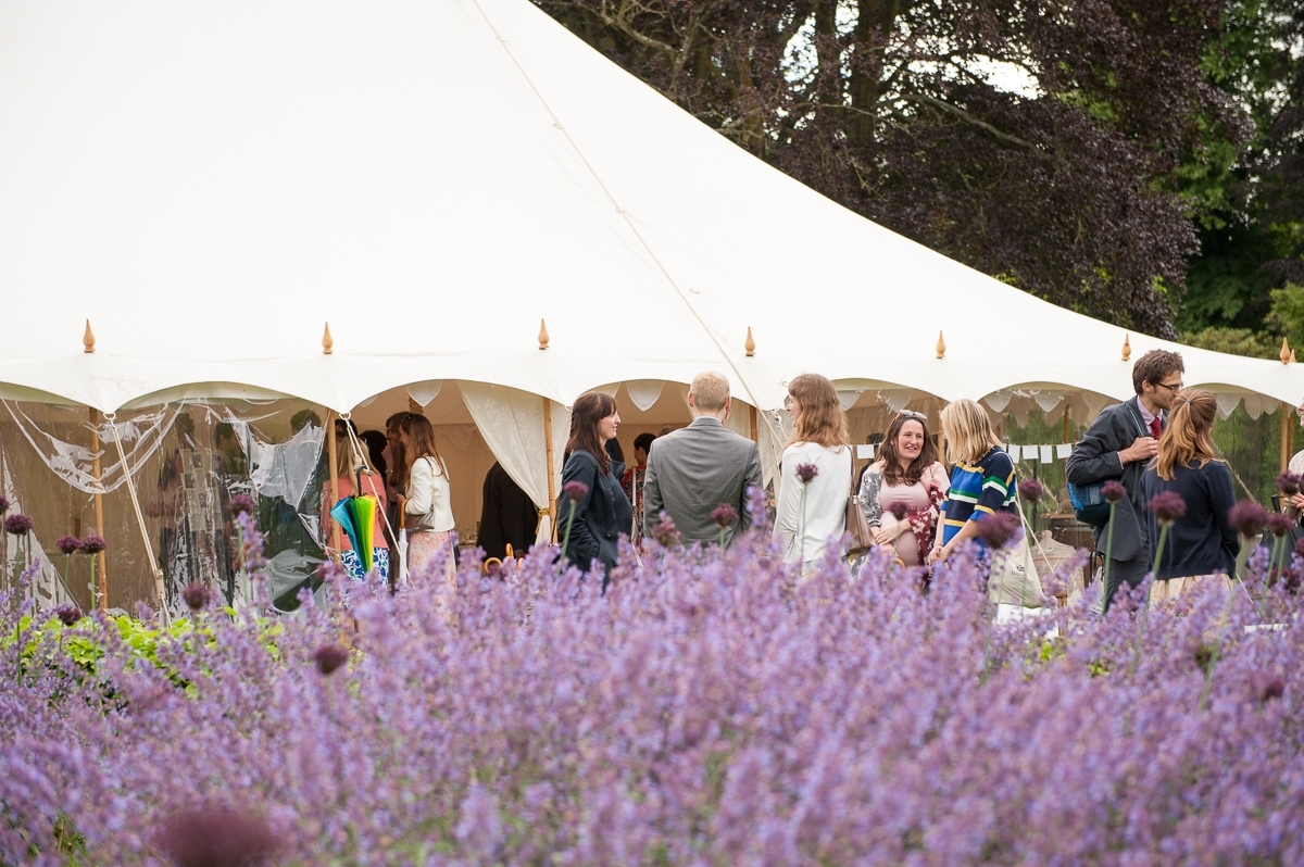 wedding marque with purple flowers at Nyamns garden