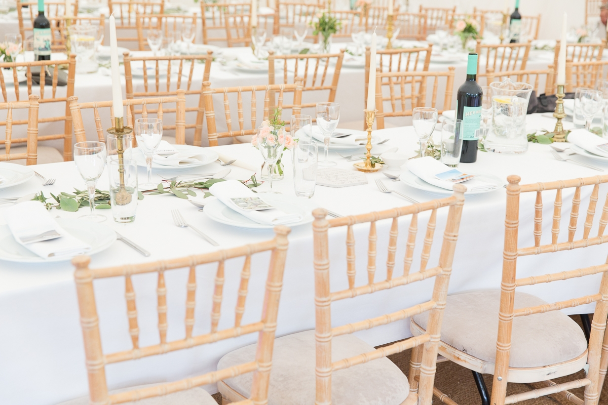 Wedding tables set up in garden marquee at East Sussex wedding