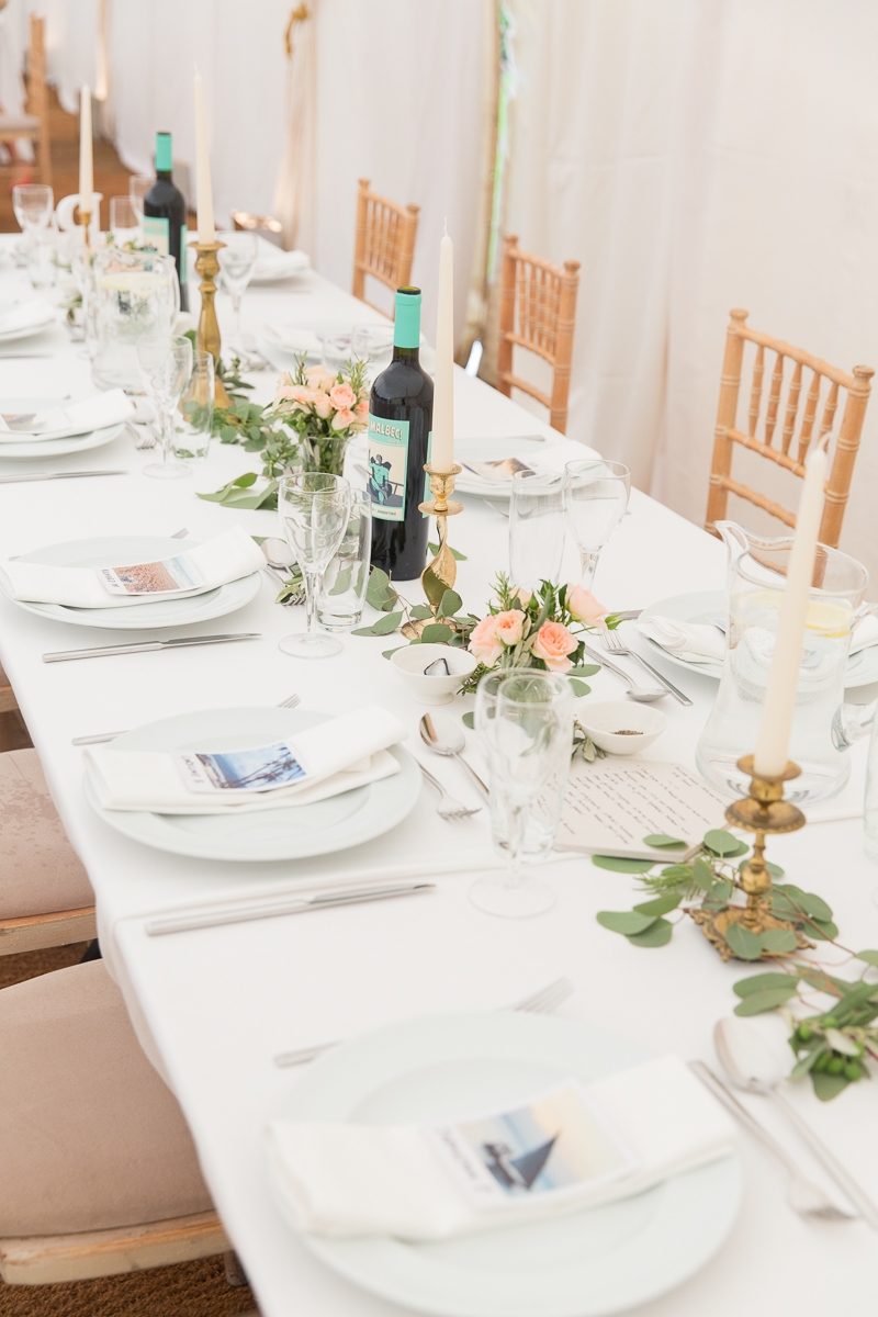 white tables decorated with eucalyptus and rosemary at Nymans Garden wedding