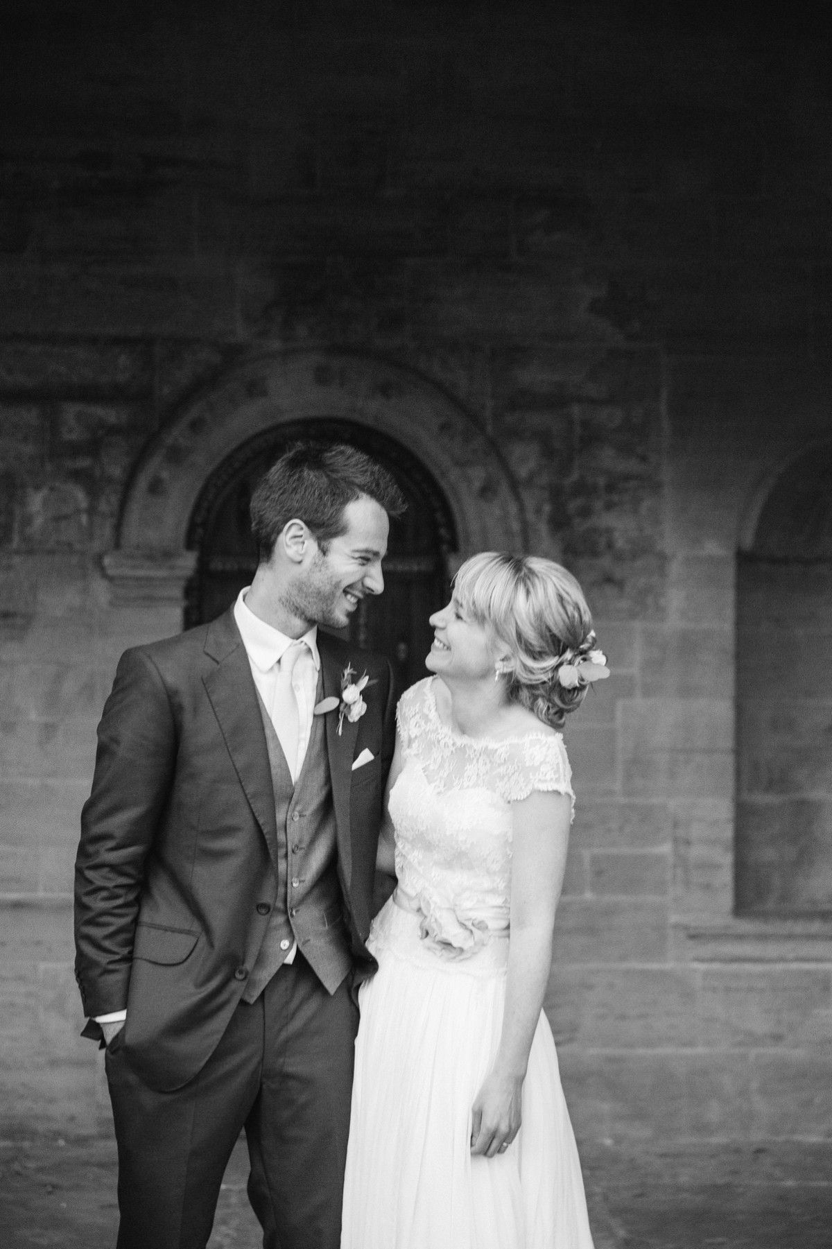 Black and white image of bride and groom at Nymans Garden