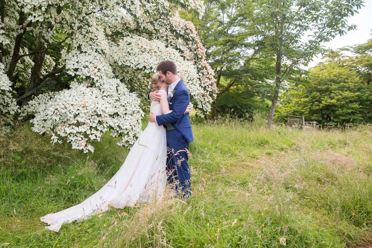 wedding couple in Nymans gardens