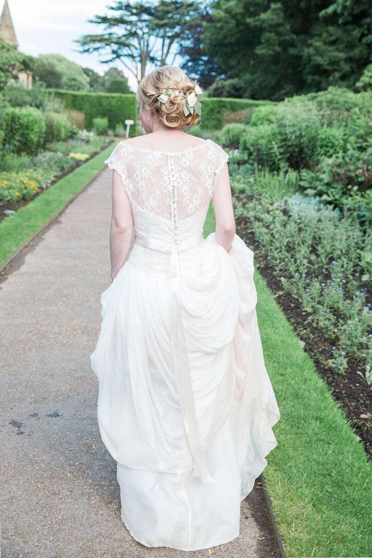 back view of Naomi Neoh wedding dress at Nyman Garden