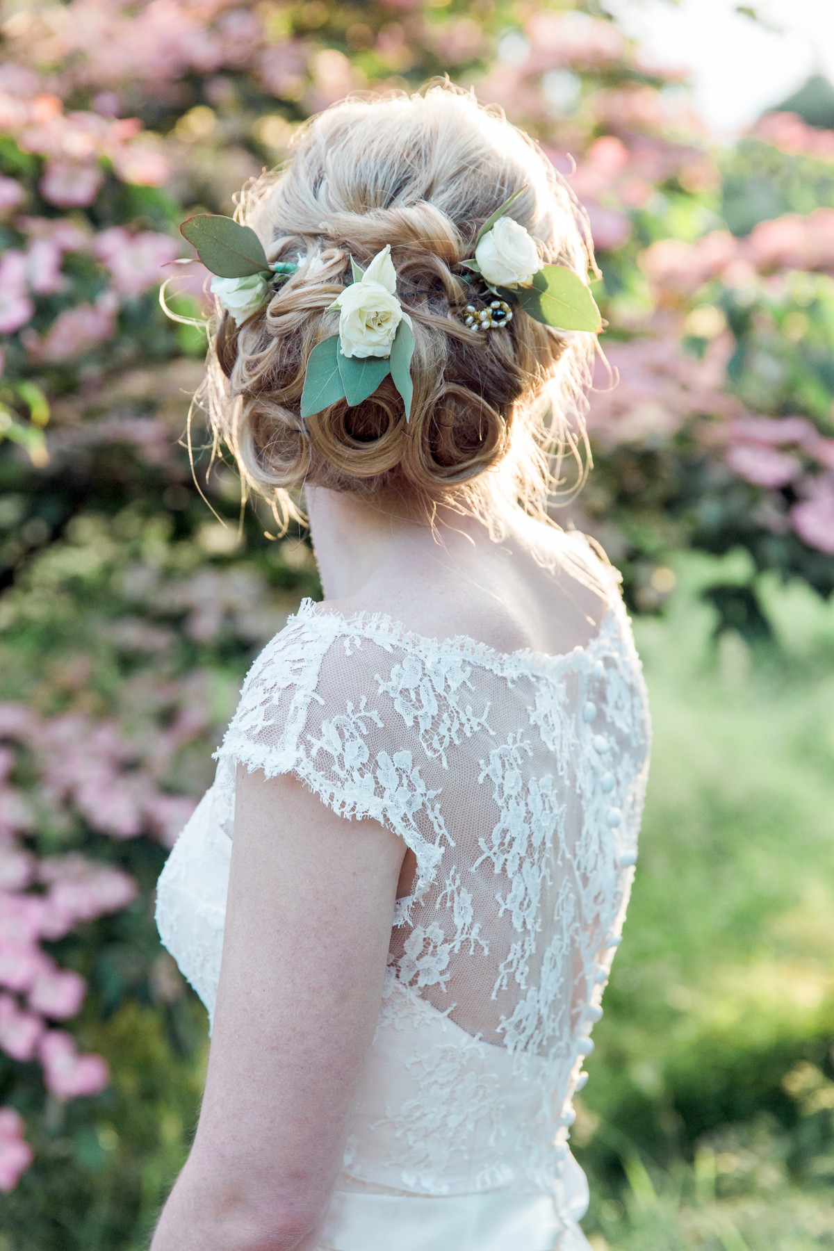 back view of bridal hair with bride wearing Naomi Neoh dress at Nymans Garden