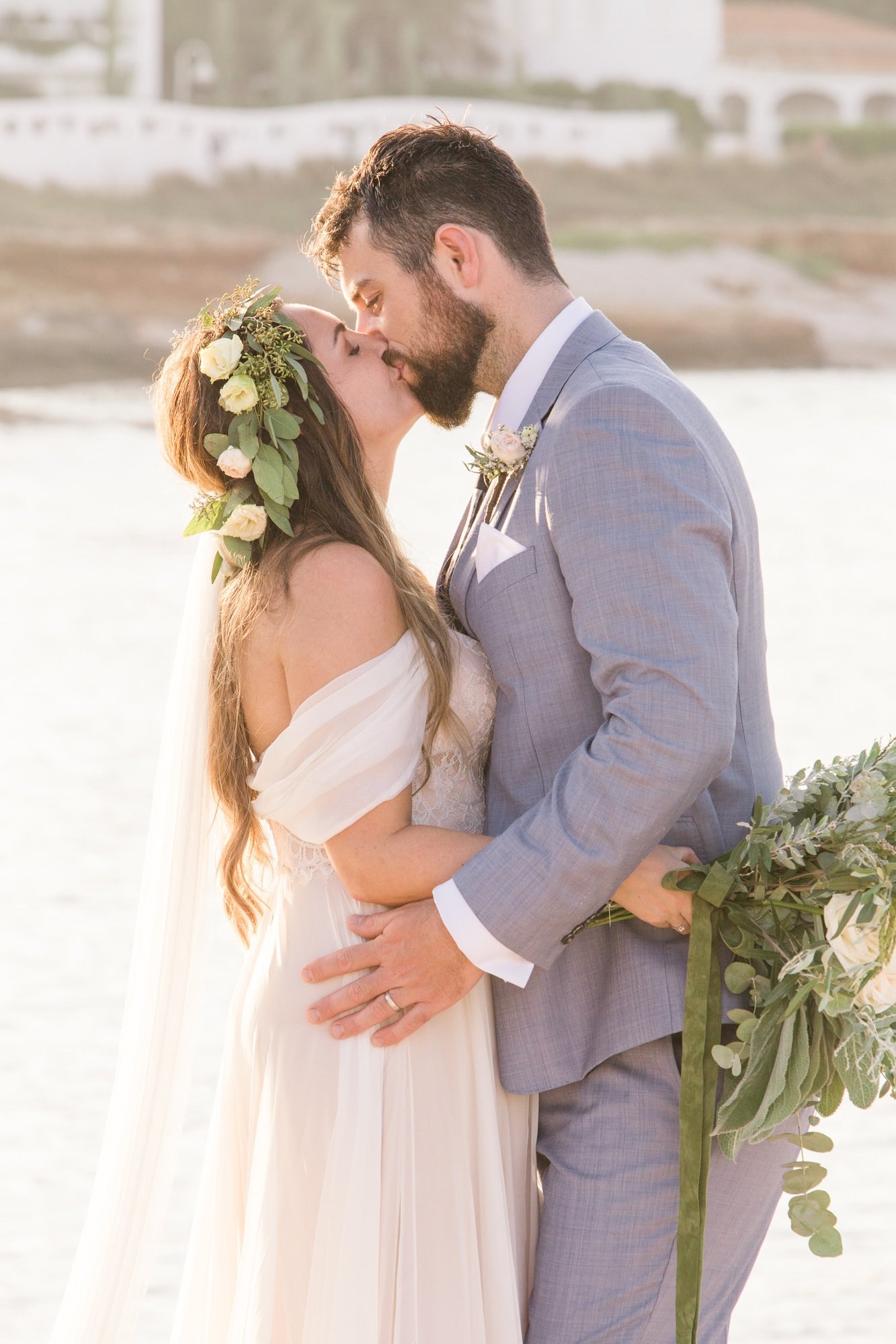 wedding couple kiss by ocean in denia, Spain