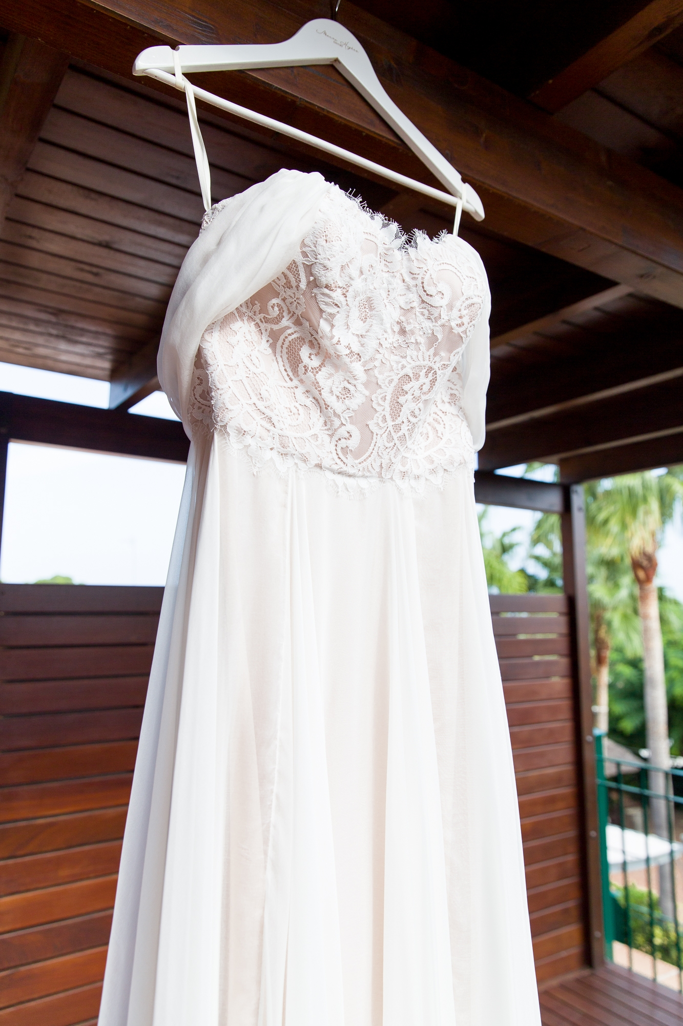 Moira Hughes Wedding dress hangs outside Hotel Les Rotes, Denia in Spain