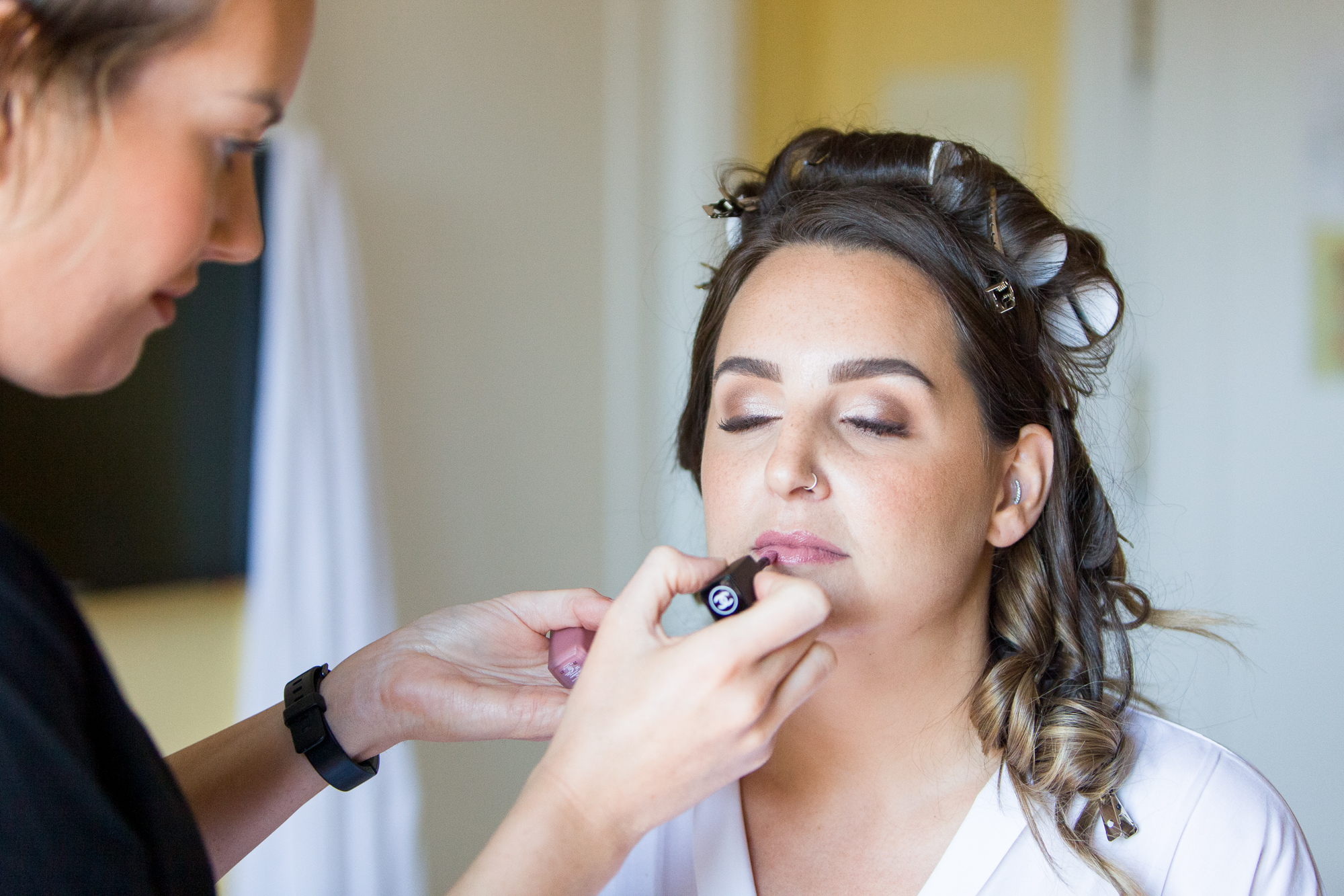 bride sits for makeup in Hotel Les Rotes, wedding in Denia