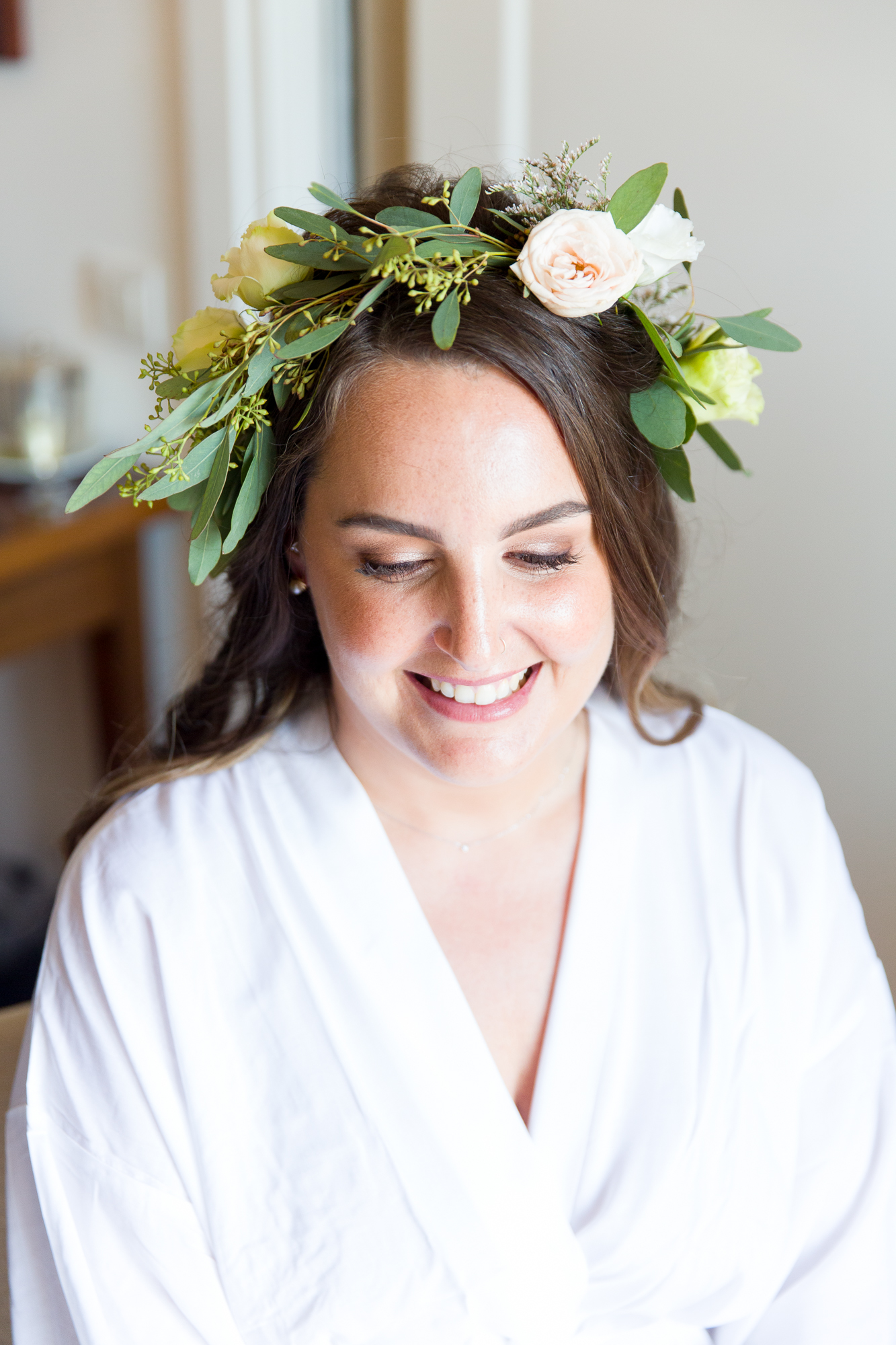 Bride smiles wearing floral crown at Hotel Les Rotes in Denia wedding