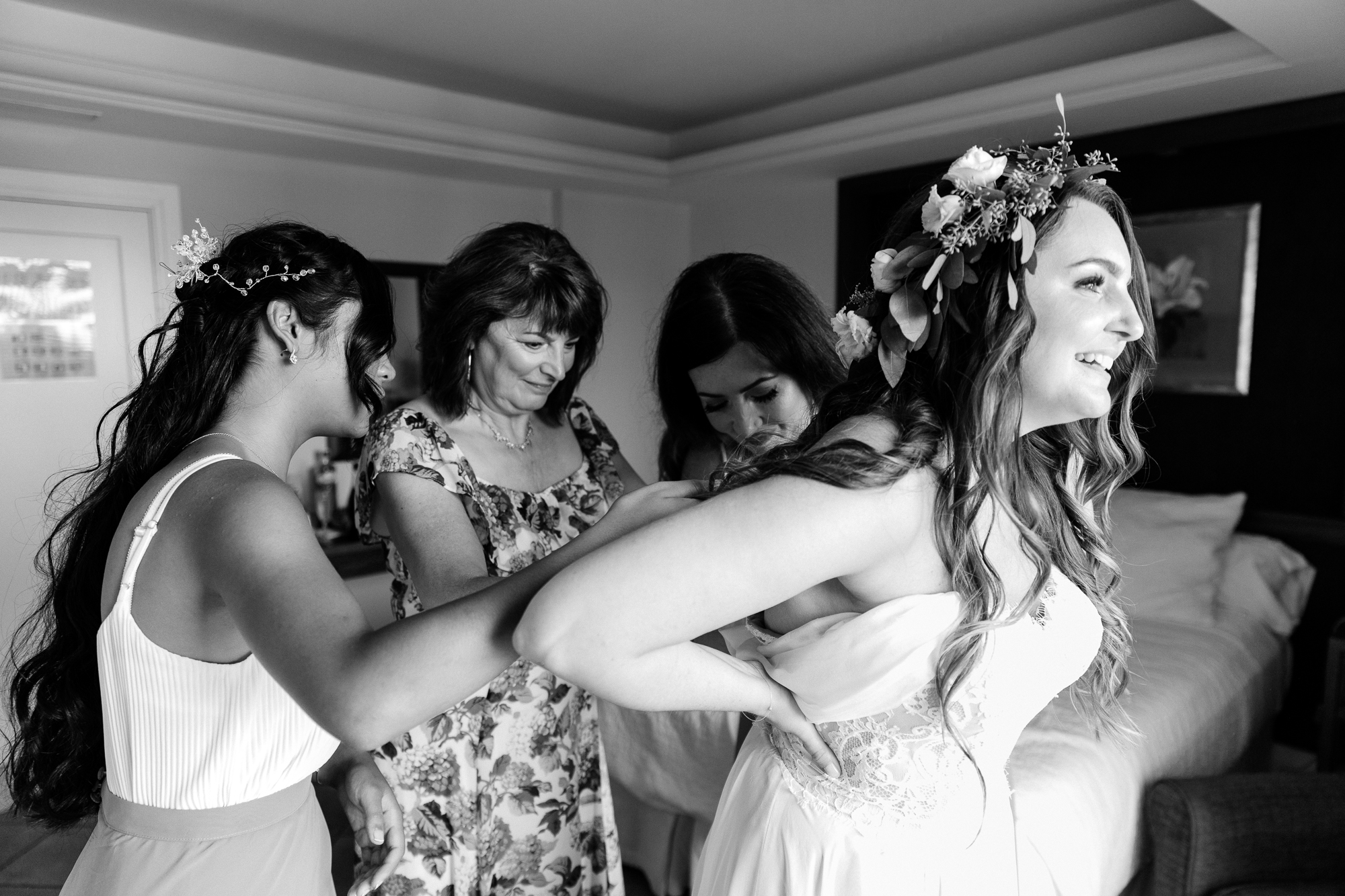Bride with floral crown gets in to Moira Hughes wedding dress at Hotel Les Rotes in Spain