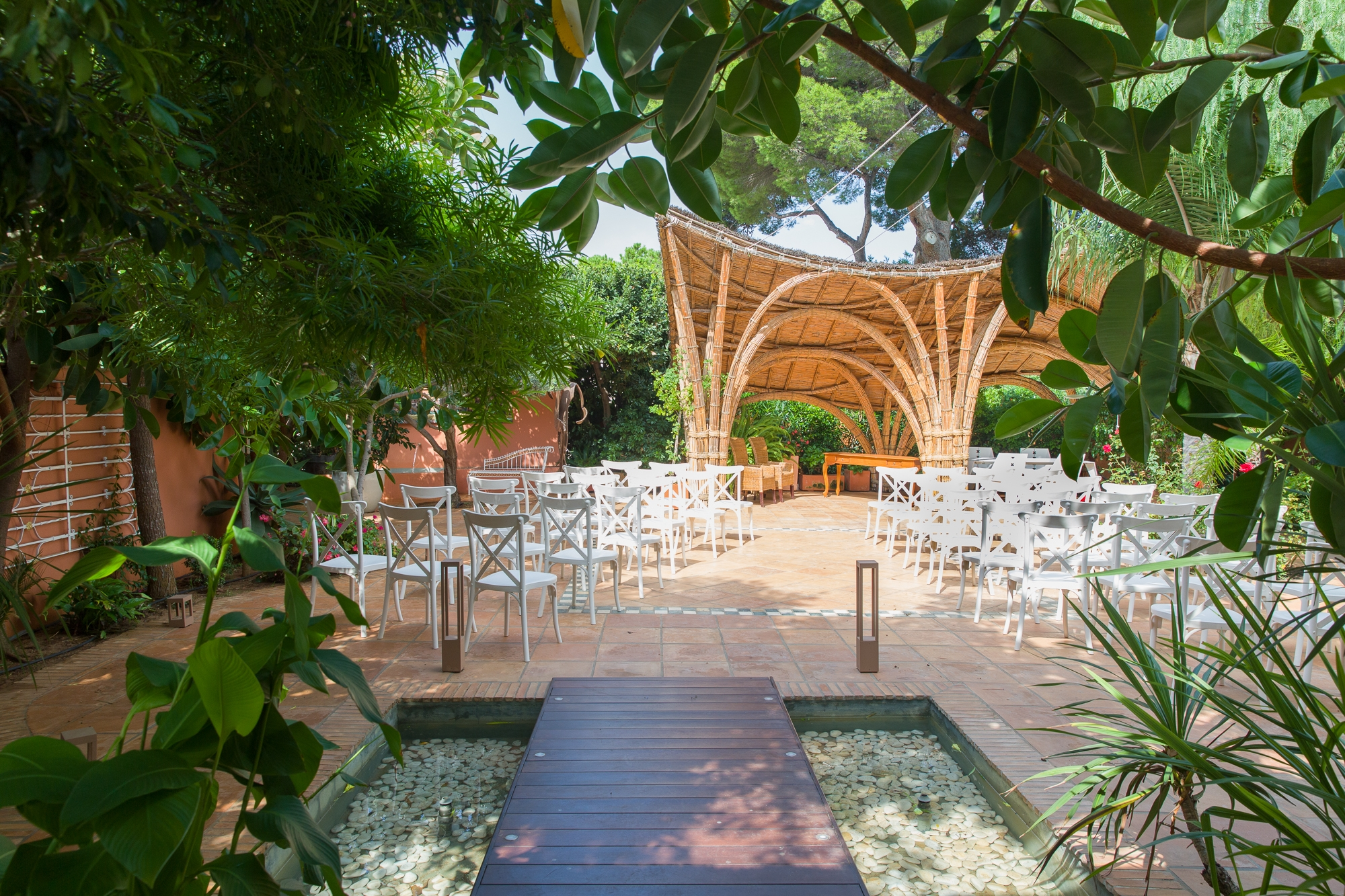the gardens of Hotel Les Rotes in Denia decorated for a destination wedding in Spain