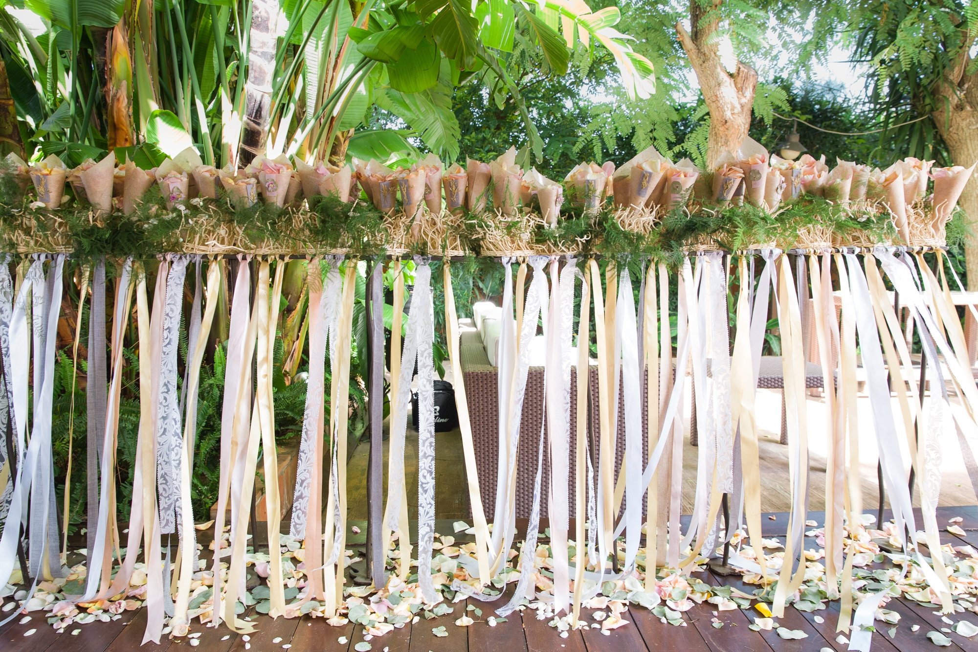 A long stand with wedding ribbons and confetti cones at Hotel Les Rotes in Denia, Spain
