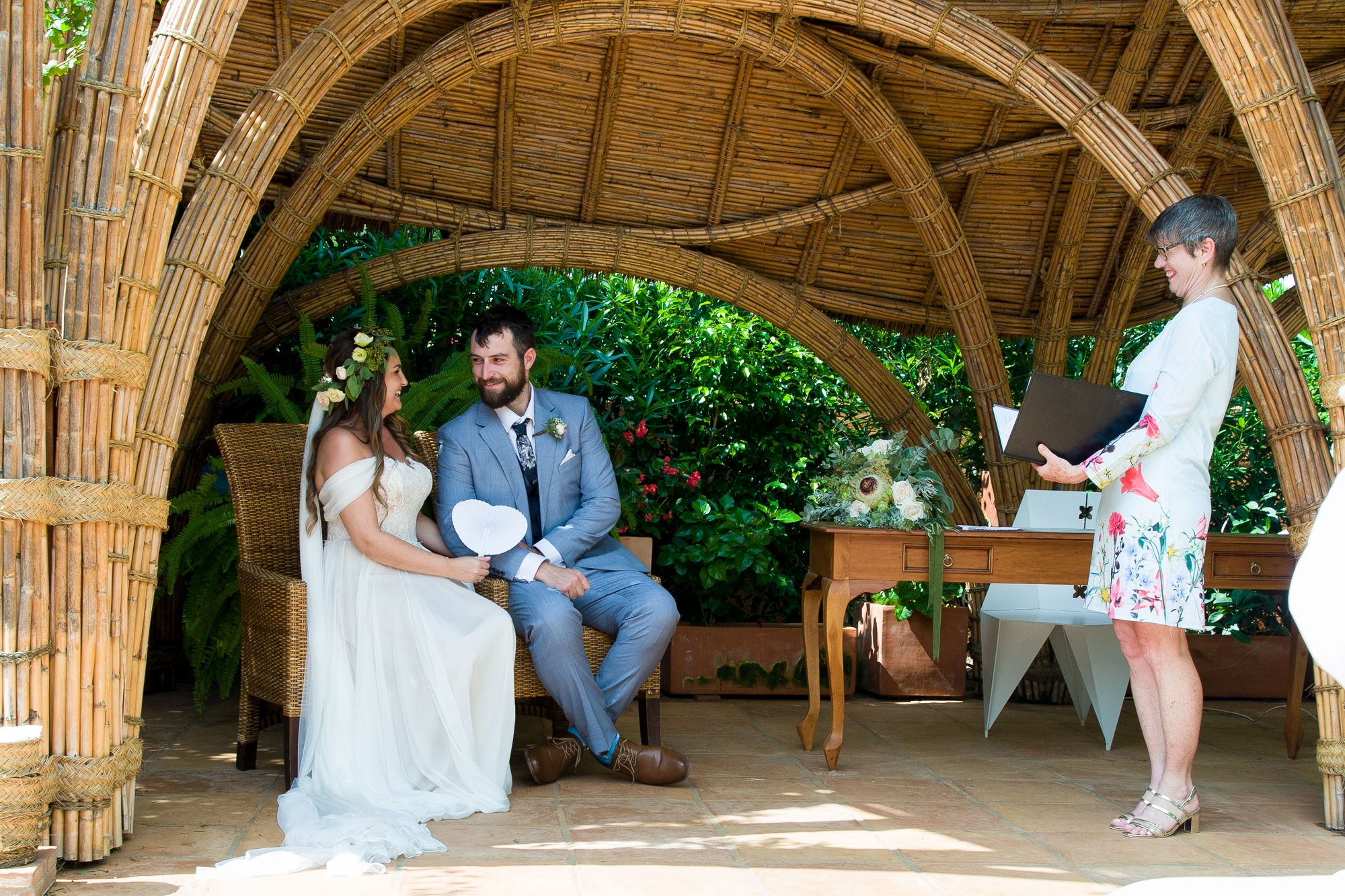 bride and groom sit looking at each other at destination wedding at Hotel Les Rotes in Spain