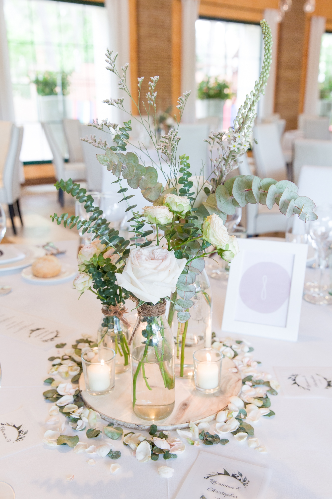 wedding table with white centrepiece at Hotel Les Rotes wedding