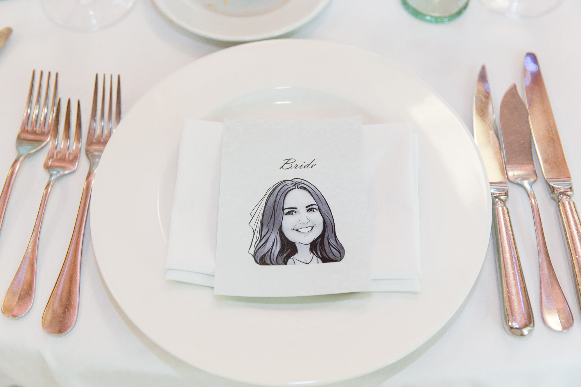 Caricature drawing on wedding table at Destination Spanish wedding