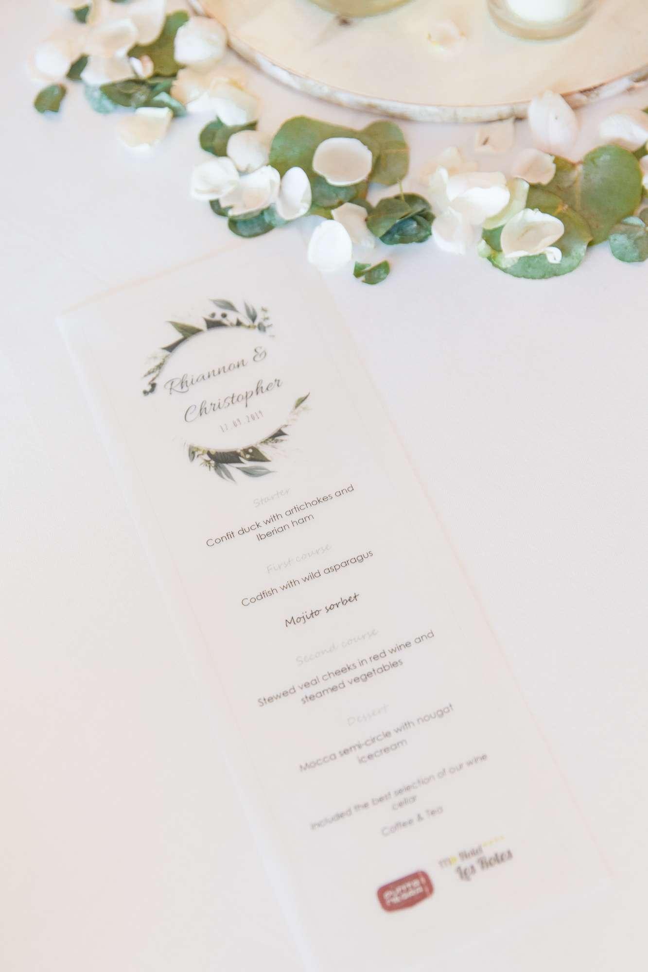 menu sits on wedding table at Hotel Les Rotes in Denai, Spain
