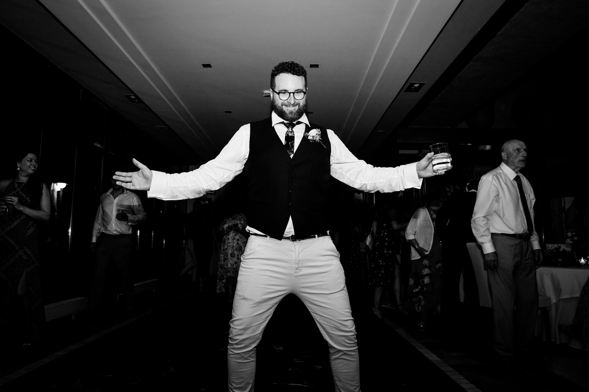 wedding guest dances in the middle of dance floor at Denia wedding