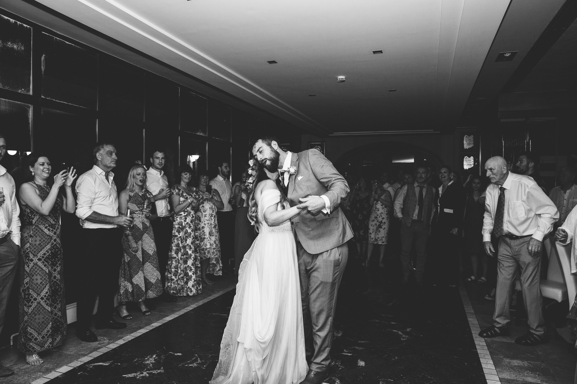 bride and groom dance surrounded by guests at Hotel Les Rotes in Denia at wedding