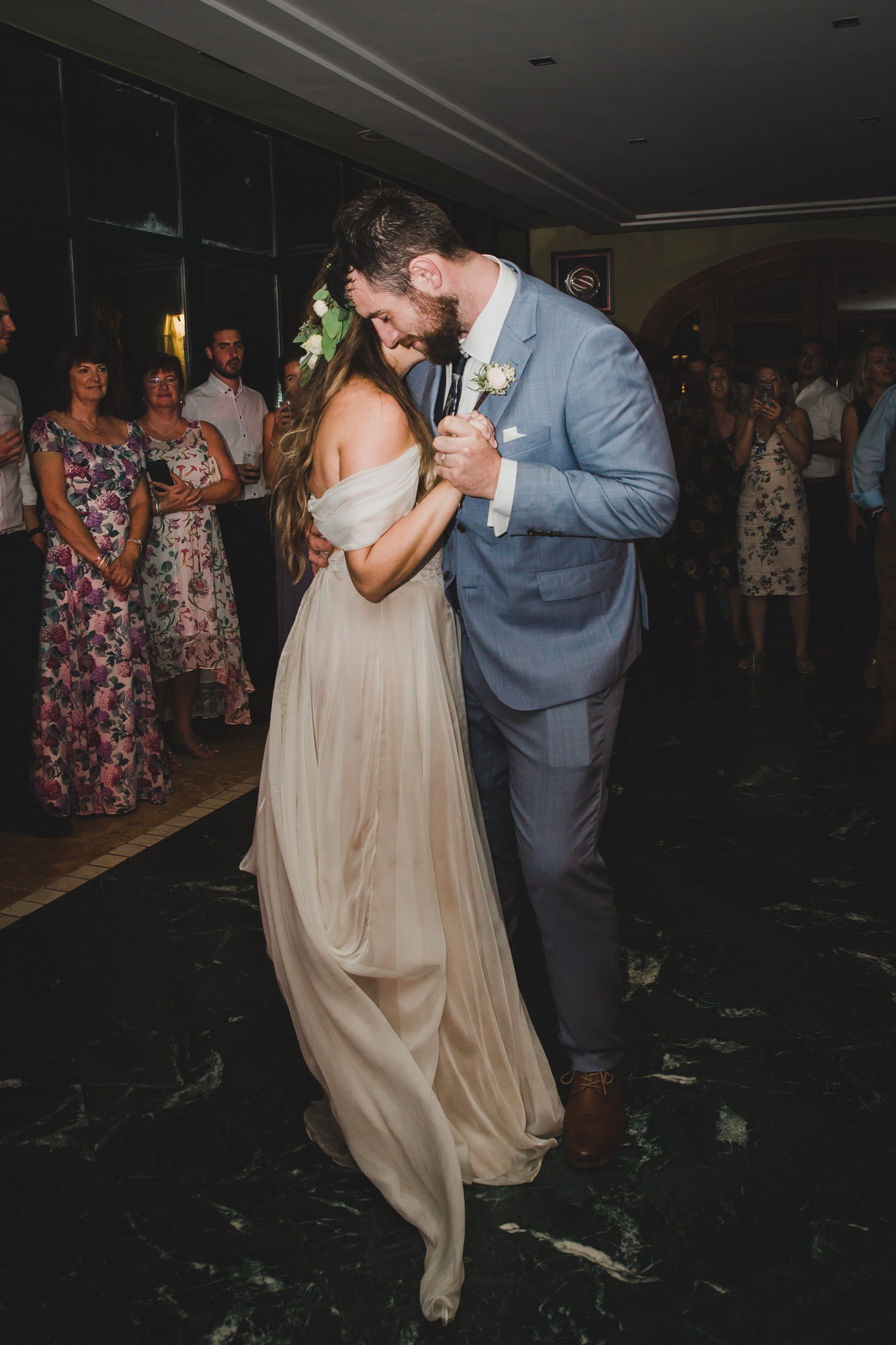 bride and groom dance surrounded by guests at Hotel Les Rotes wedding in Spain