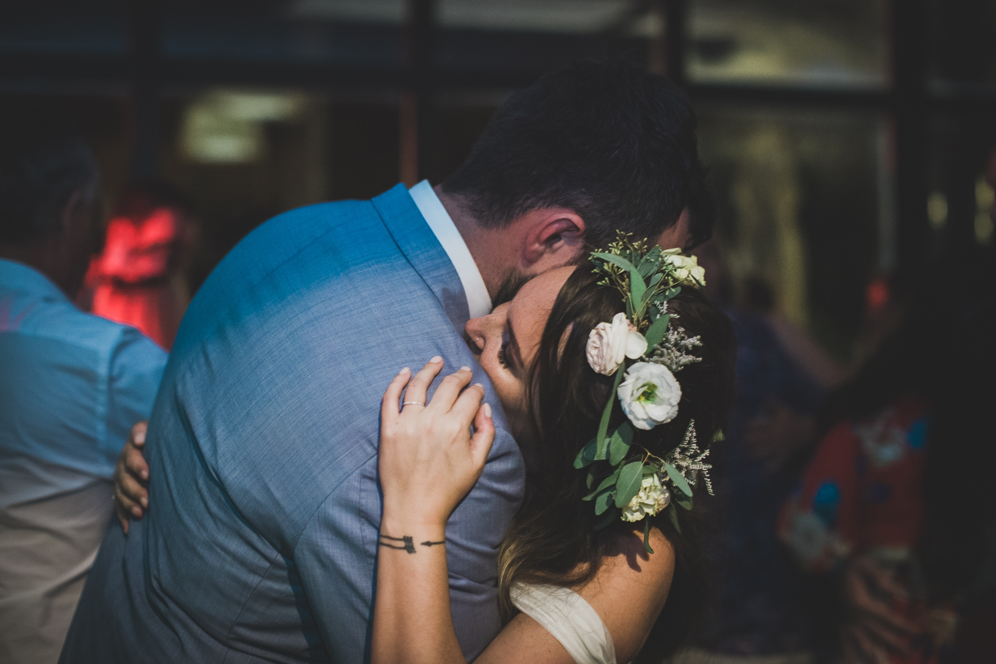 bride and groom cuddle during dancing at Spanish wedding
