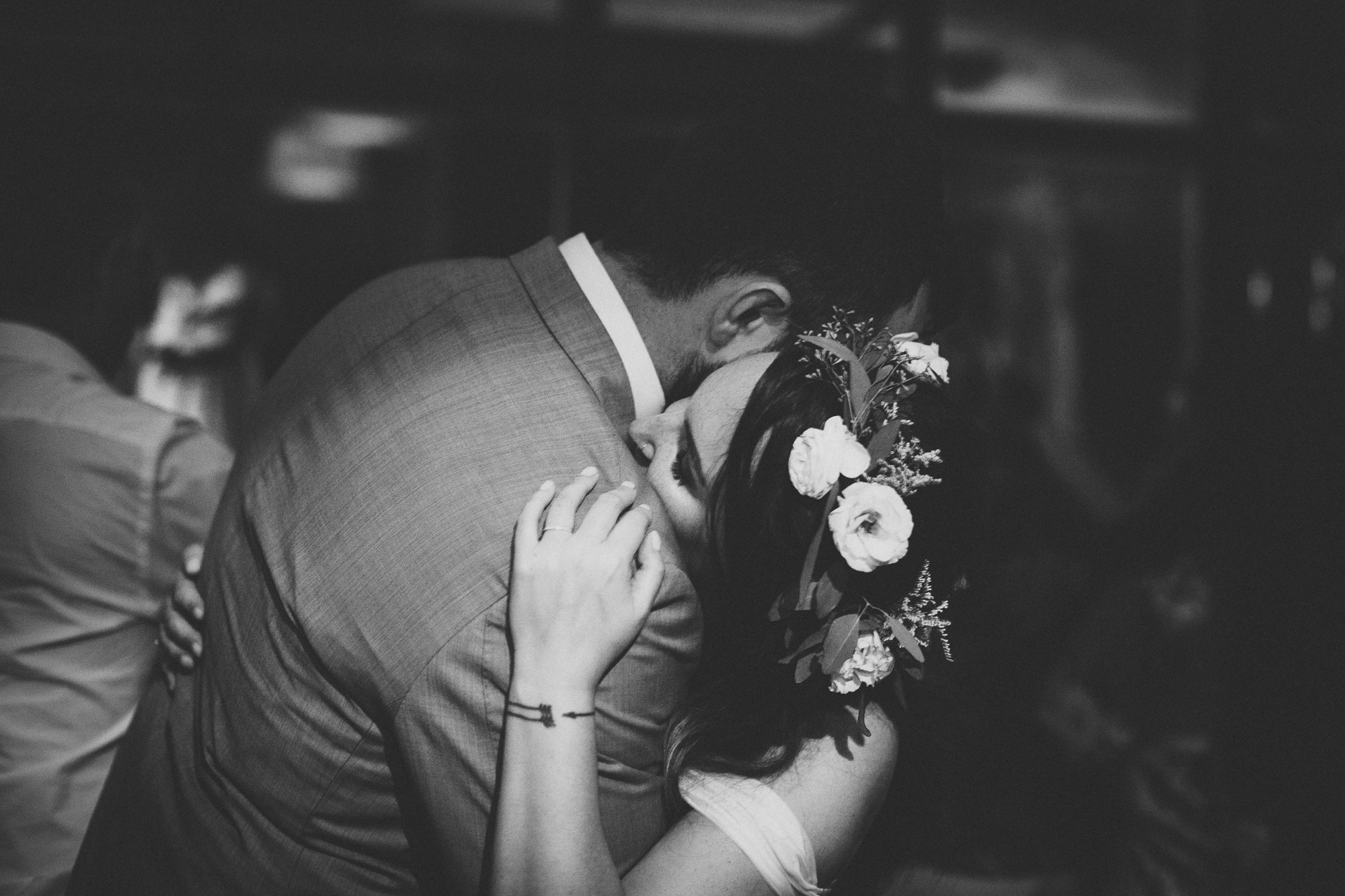 bride and groom cuddle during dancing at Spanish wedding (black and white)