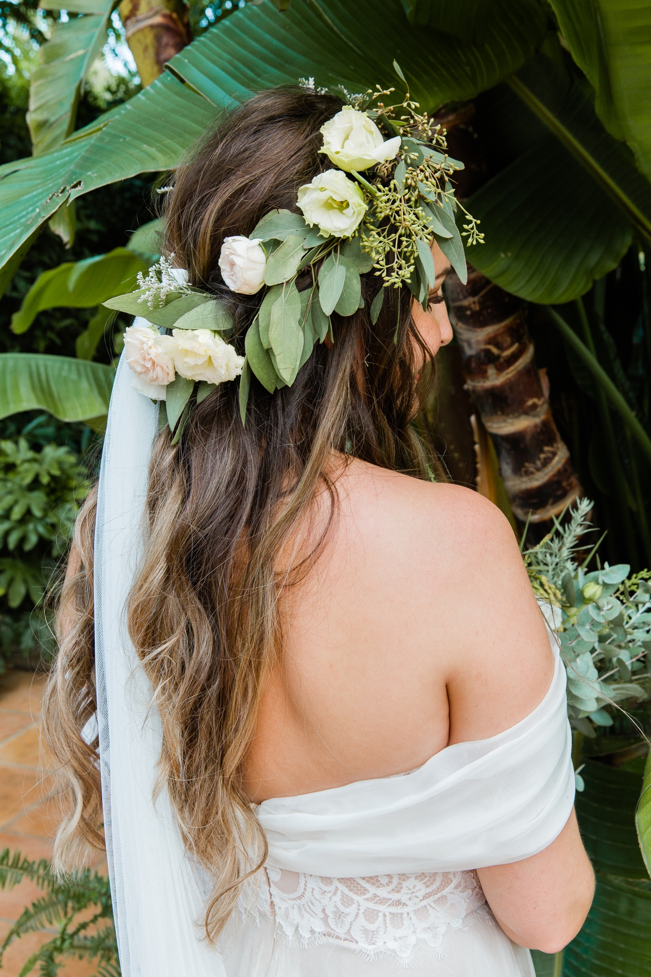 back of bride with floral crown, veil and Moira Hughes wedding gown